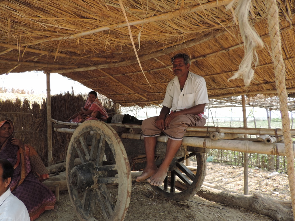 A resident of Amanat diara sits at a cart that would double up as home for them during monsoon when the whole village gets marooned, forcing them to spend days and nights in the cart with women and children.