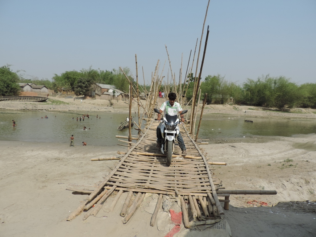 A biker uses the bamboo bridge connecting Pyarpur and Amanat diara. Bikers have to pay Rs 5 for the service. The makeshift bridge is built by local people.