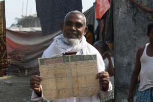 a elderly Muslim showing his land documents in a relief camp in Kokrajhar