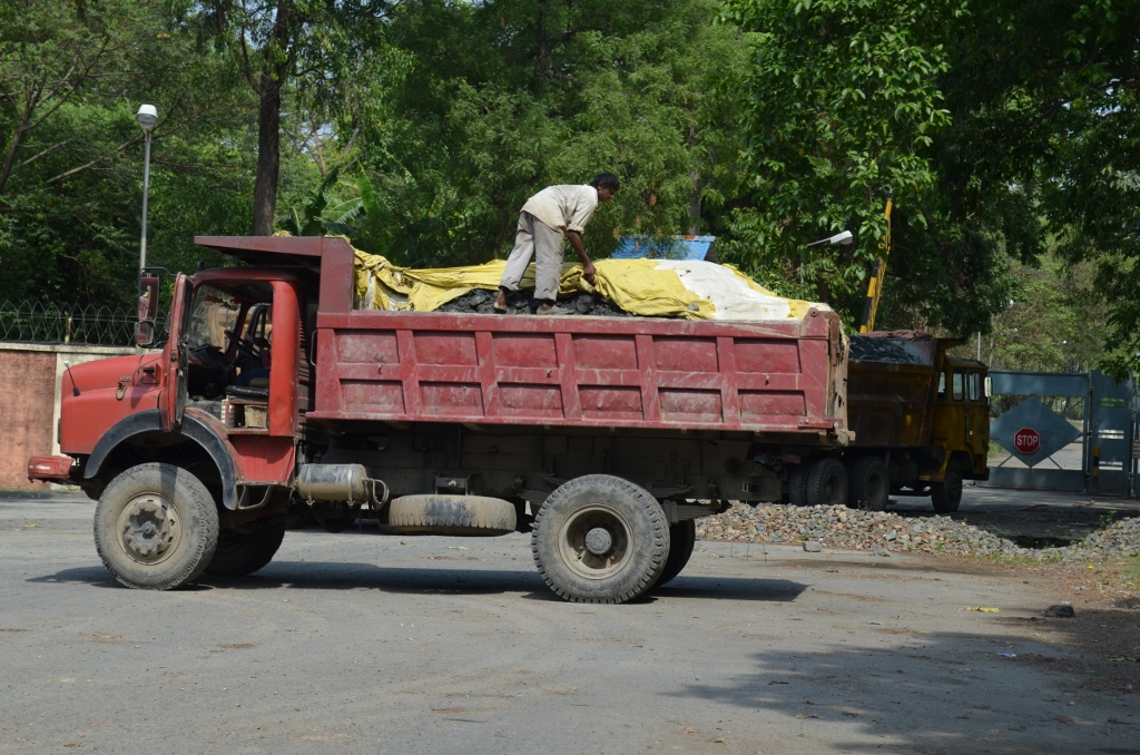 A helpers working barefoot on trucks carrying the Uranium wastes is also exposed to high levels of radiation | Photo: Ashish Birulee