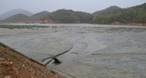 A tailing pond at Jadugoda; refuse material from the mines are pumped into the pond | Photo: Ashish Birulee