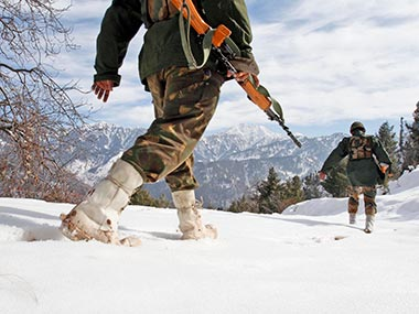 Indian army soldiers patrol near the Line of Control (LOC), that divides Kashmir between India and Pakistan, in Churunda village; file photo. Image used for representational purposes only. Associated Press