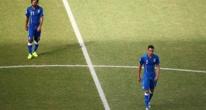 A dejected Andrea Pirlo (L) and Mattia De Sciglio of Italy walk off the pitch | Getty images