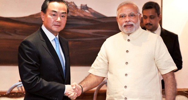 Wang Yi and Narendra Modi meet in New Delhi. Photo: AFP
