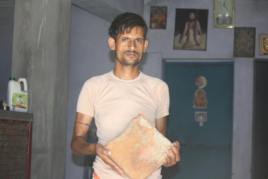 Sushil Koirala holding a square brick (1024x683)