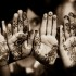 Indian Muslim women henna their hands for important festivals, such as Eid. Izzah Zainab under a Creative Commons Licence
