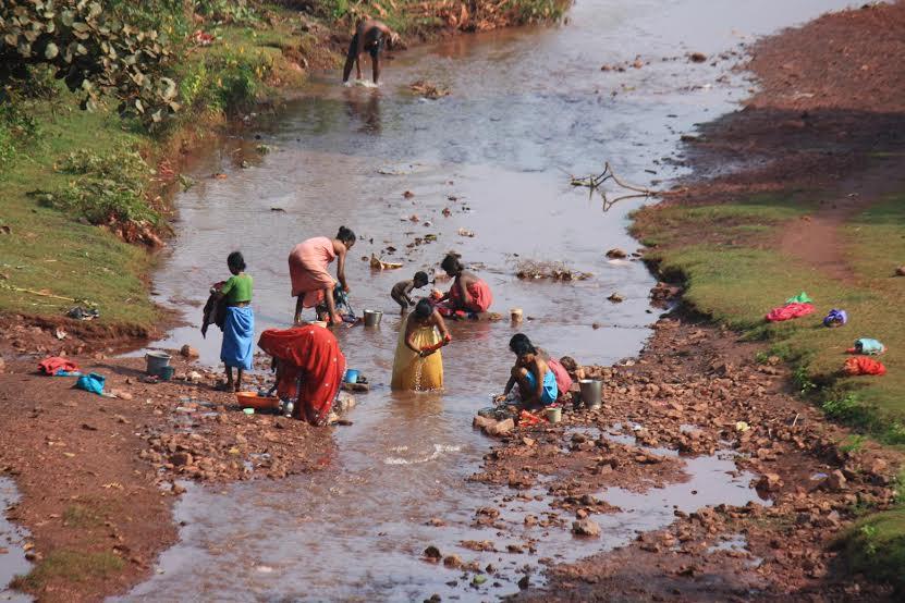 women taking bath in a downstream - dalli rajhara