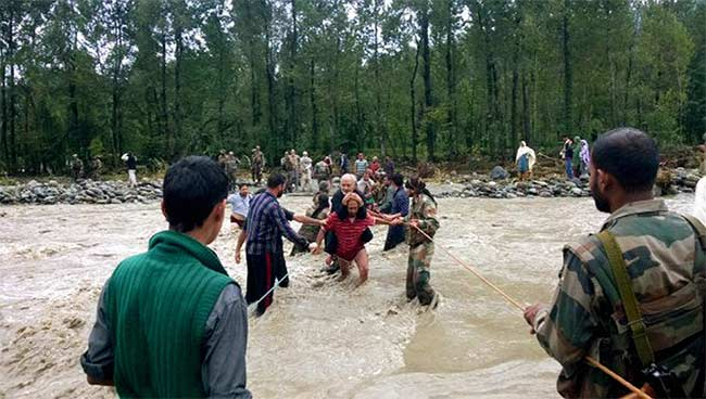 Army jawans rescue stranded people across a stream in Jammu | Photo: PTI
