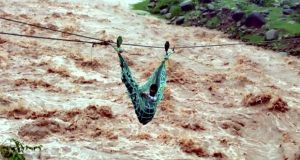 A villager being rescued using a rope | Photo: PTI