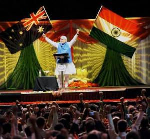 Modi gestures and the crowd follows at Australia | Photo :PTI