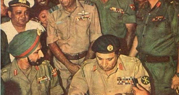 Signing of Surrender Document on 16 December 1971 | Lt. General A. A. Niazi of the Pakistan Army signs the instrument of surrender as Lt. General J. S. Arora looks on