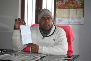 anil mahavir displaying list of people who died or are suffering from cancer in Kheda Dharampura