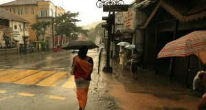 A woman walks in the rain in Sri Lanka. Sharmila Seyyid, a Sri Lankan poet who bravely speaks out on women's rights, hopes for a brighter future. planetlight under a Creative Commons Licence