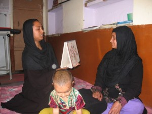 Besides counselling her on methods of improving her reproductive health, Sameena (left) helped Rashida (right) avail of free medicines and immunisation   Photo Credit: Abha Sharma/WFS