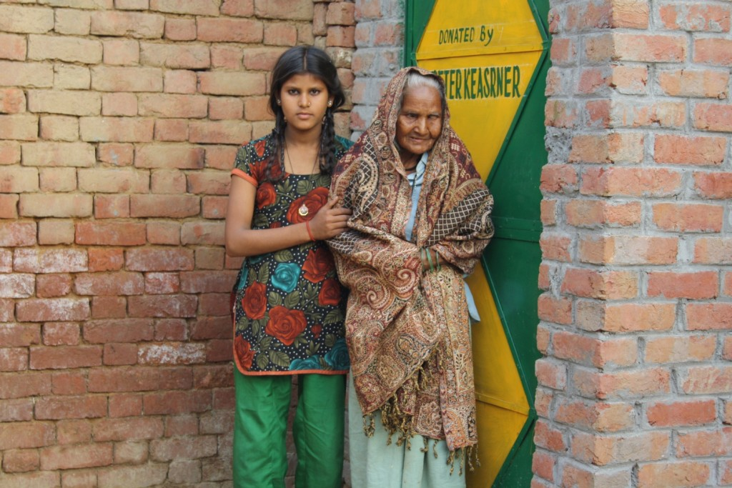 Maneesha, an orphaned class VIth student, with her grandmother outside toilet built by her school1