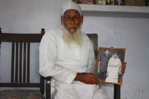 Qadri holding an old photo of his with wife Tajammuli
