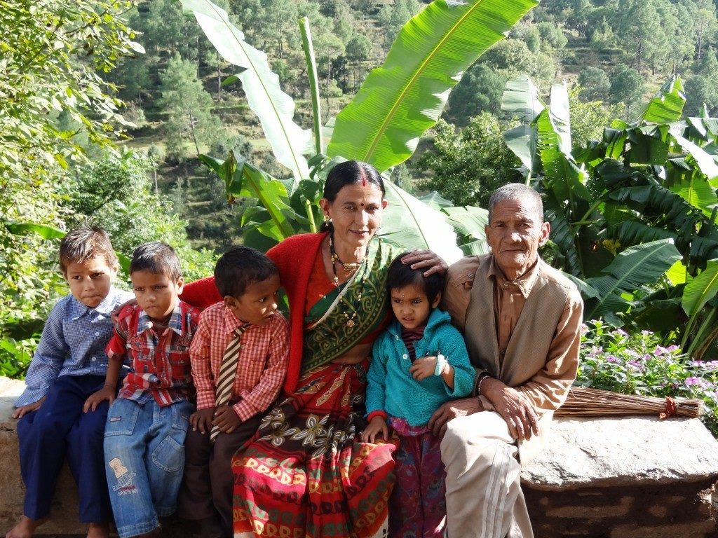 Munni Adhikari, Sarpanch of the Dhaura Van Panchayat in Lamgara block of Almora district with her husband and grandchildren. Munni is convinced that women's presence on the nine-member forest council can help in real conservation as women are dependent on forests. (Credit: WFS)
