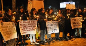 Women carrying candle lights and placards condemning atrocities against women in the North east | Credit : http://www.ohmeghalaya.com