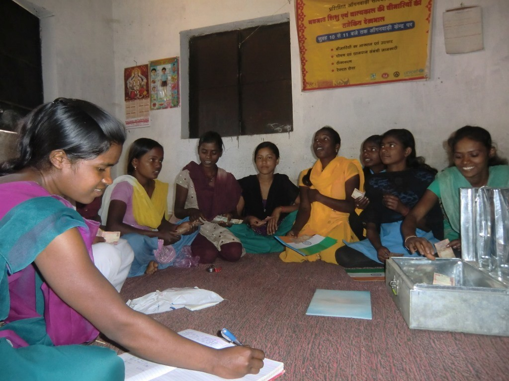The girl gang of Jidu Pandra Toli Kishori Mandal takes a stock of their accounts as part of their micro-credit venture that allows them to take small loans as and when the need arises. (Credit: Ajitha MenonWFS)
