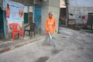 medicine monk sweeping his street