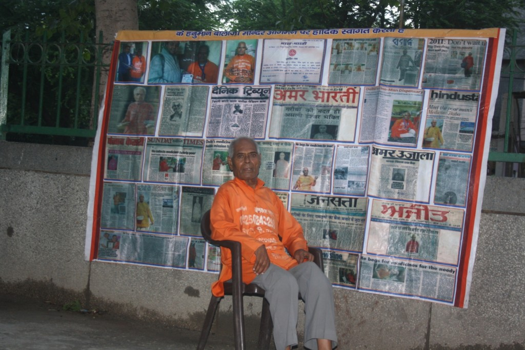medicine monk with newspaper clippings