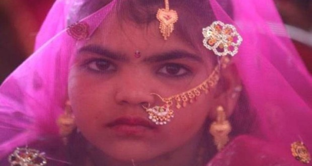 A teen girl in her marriage costume | Photo- Creative Commons